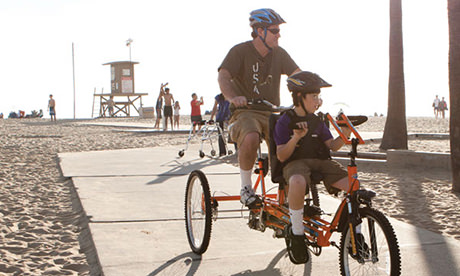 Man with son on Adaptive Bike