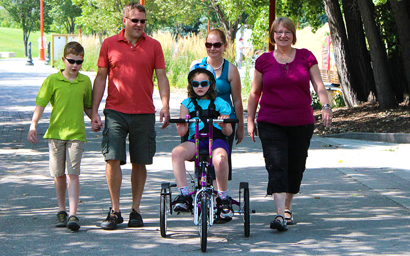 Family Out for Bike Ride at Park